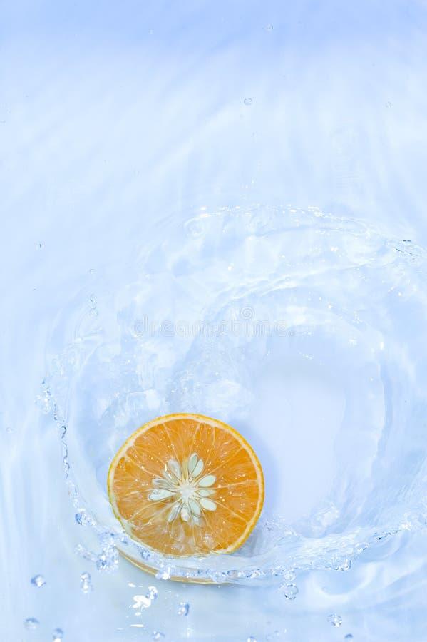 Orange with splashing water royalty free stock image
