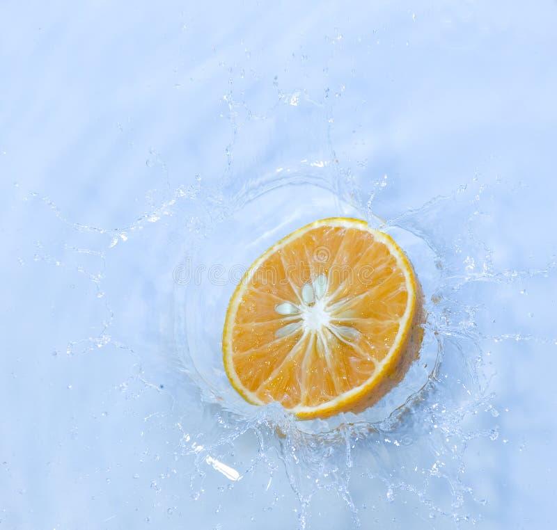 Orange with splashing water royalty free stock images