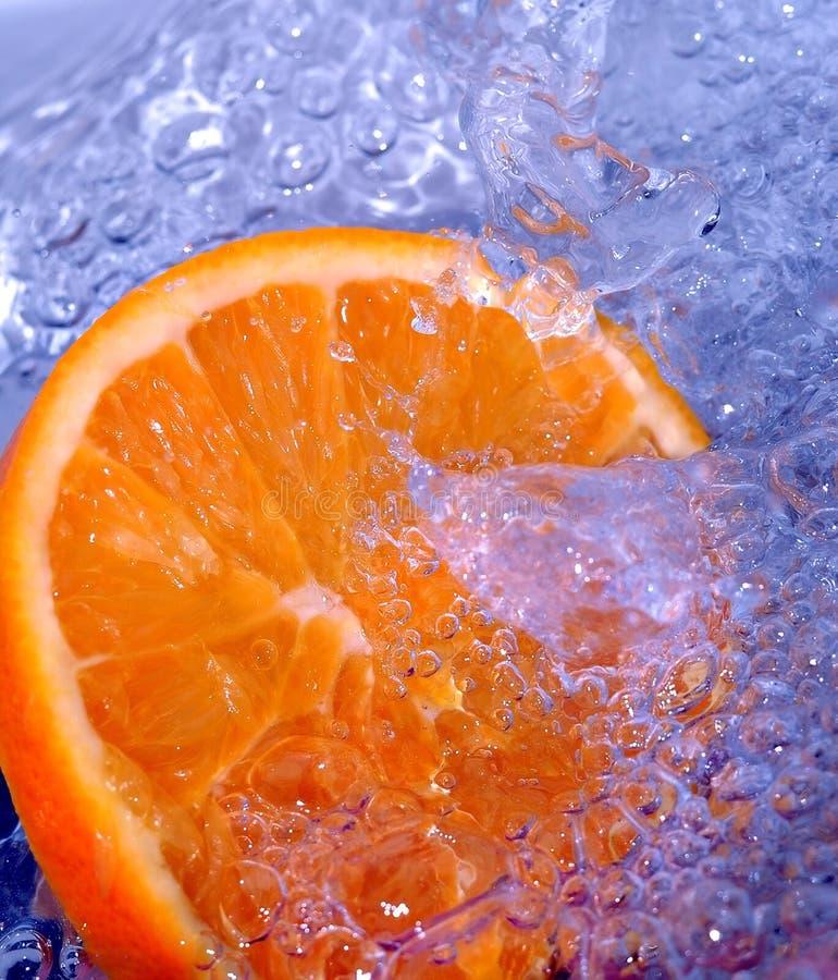 Free Orange Splashing Water Stock Image - 700281