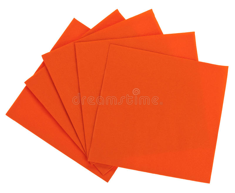 Orange square paper serviette (tissue). Isolated on white royalty free stock photo