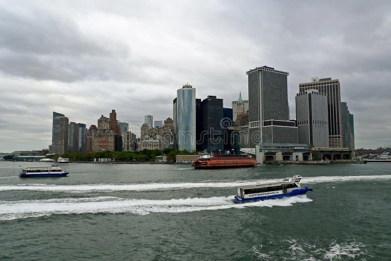 Staten Island and NY Waterway Ferry, New York city. Orange Staten Island Ferry connecting Manhattan with Staten Island, and New York Waterway Ferry, New York stock photos