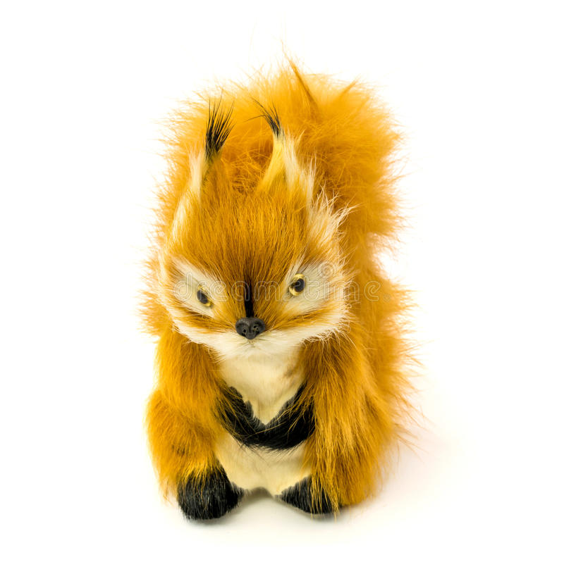 Orange statuette of a squirrel isolated on a white background. Photo of an orange statuette of a squirrel isolated on a white background royalty free stock images