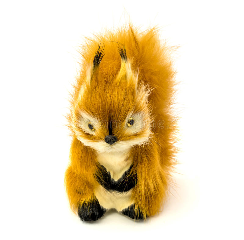 Orange statuette of a squirrel isolated on a white background. Photo of an orange statuette of a squirrel isolated on a white background stock photos