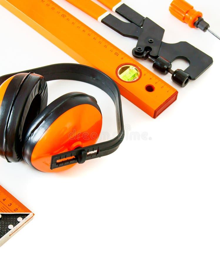 orange stil Funktionsdugliga hjälpmedel på en vit bakgrund royaltyfri fotografi
