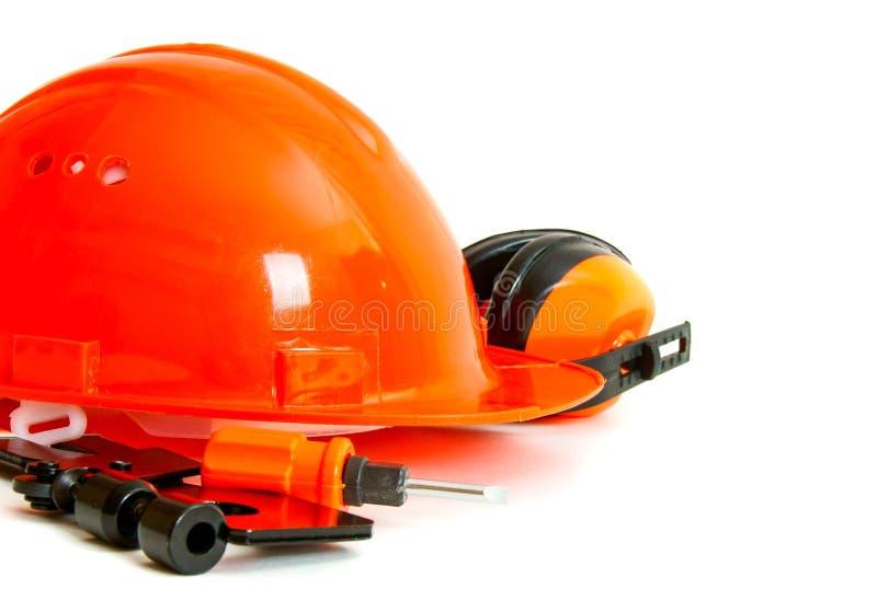 orange stil Funktionsdugliga hjälpmedel på en vit bakgrund arkivfoto