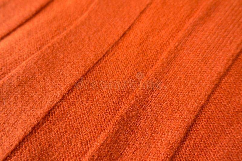 Orange stockinette Gewebe mit diagonalen Entlastungsstreifen lizenzfreies stockbild