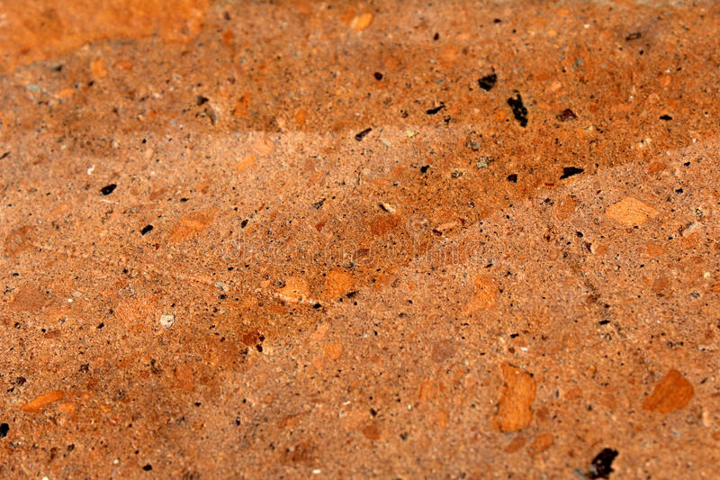 Orange stone texture. With some other color flakes an some scratches royalty free stock images
