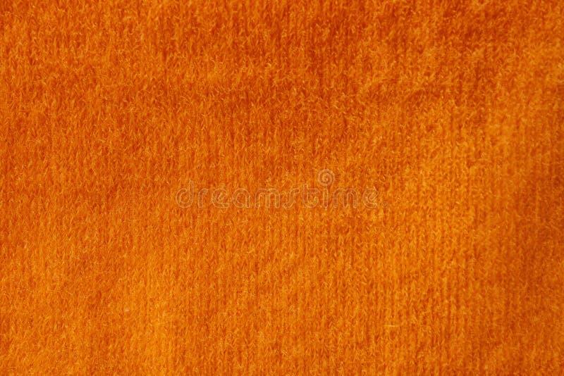 Orange stucken tygtextur som bakgrund royaltyfri foto