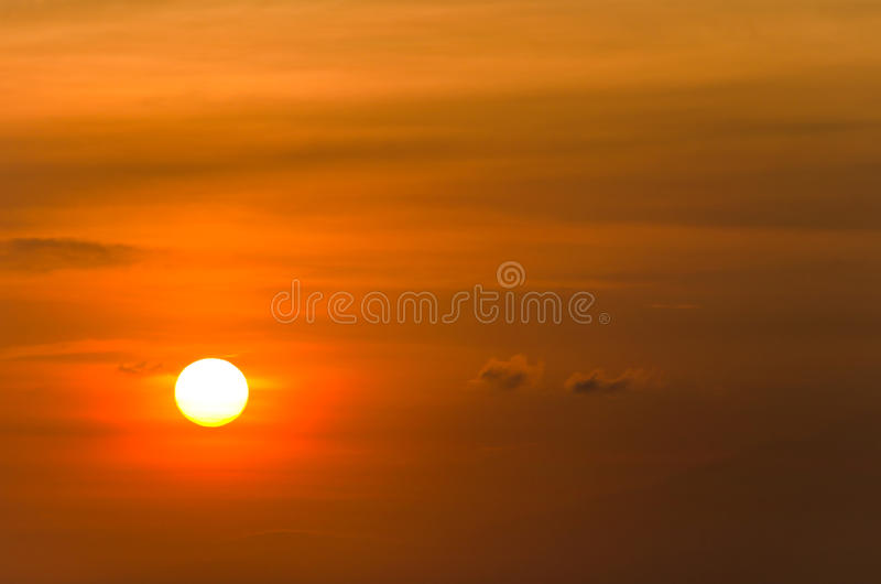 Orange sun with a glow. With pathy cloudscape royalty free stock image