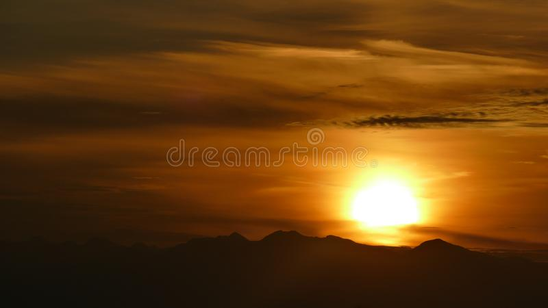 Orange sun. A magical moment in which it is orange. Poland. Orange sun. A magical moment in which it is orange. Here the sun is over the mountains of the High stock image