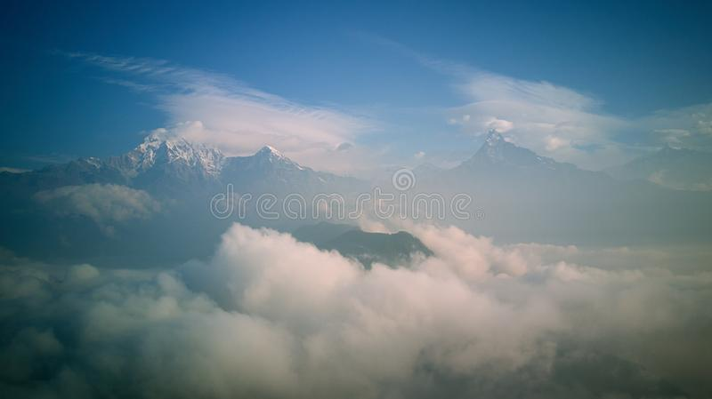 Orange sunrise above mountain in valley Himalayas mountains stock photography