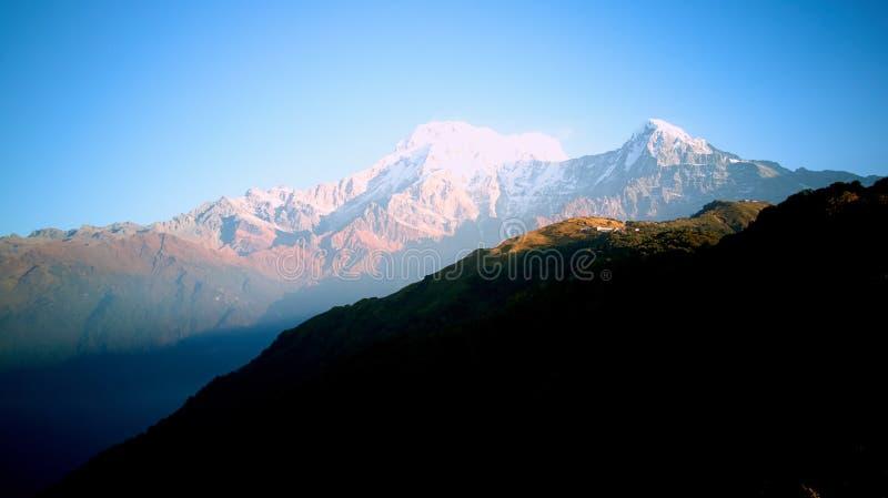 Orange sunrise above mountain in valley Himalayas mountains stock image