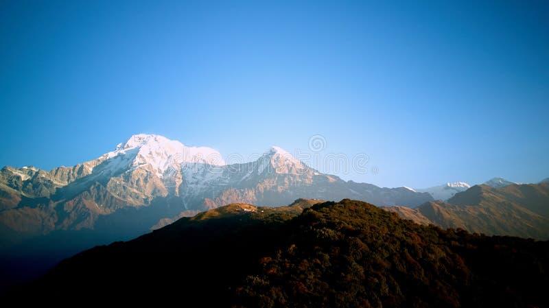 Orange sunrise above mountain in valley Himalayas mountains royalty free stock photo
