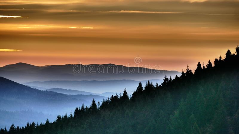Orange sunrise. Before it finally arises, it shines briefly in orange. This is the moment. Mountains of the High Beskid. Poland. Europe stock photography