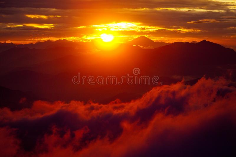 Orange sunset above mountain in valley Himalayas mountains royalty free stock photo