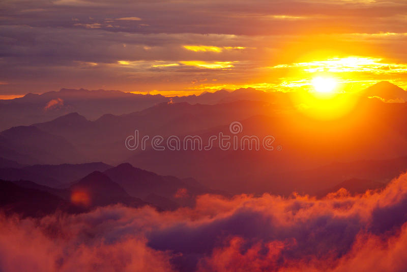 Orange sunset above mountain in valley Himalayas mountains stock photos