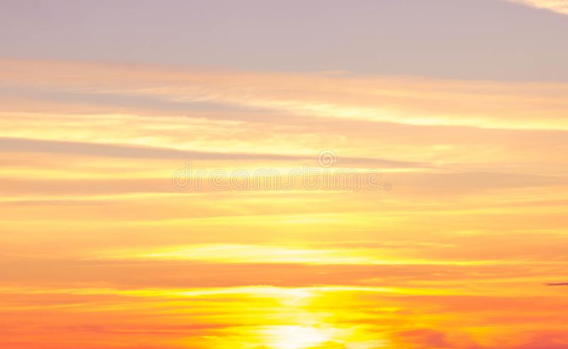 Orange sunset abstraction. Blue sky, sun, clouds stock image