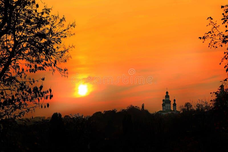 Orange sunset with beautiful evening landscape. Twilight with bright sunset. royalty free stock photos