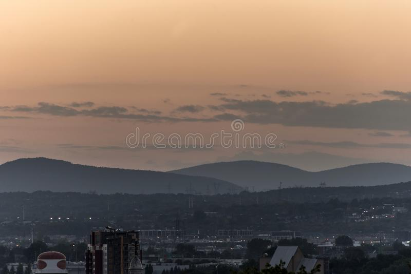 Orange sunset behind the mountains Quebec City Canada.  royalty free stock photos