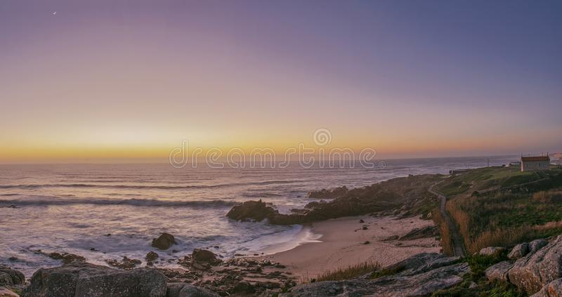 beach and church under the orang light of the sunset stock photography