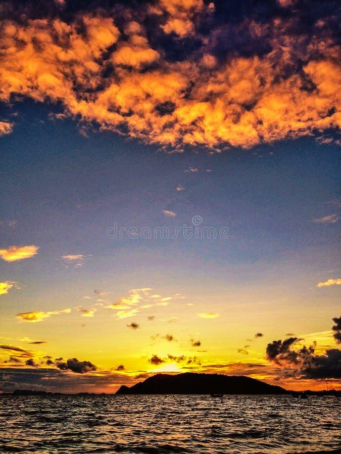 Orange sunset. Orange colored sunset with clouds royalty free stock photo