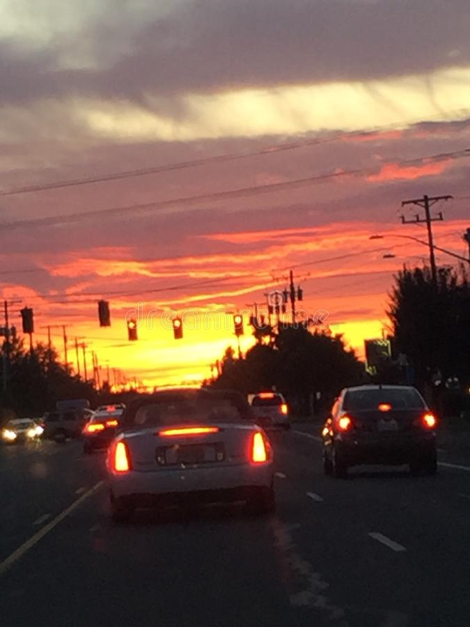 Beautiful sunset driving down the road royalty free stock photos