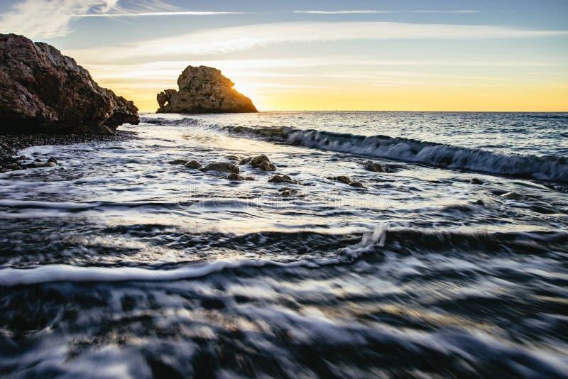 Orange sunset over a calm ocean, Malaga Beach stock photos
