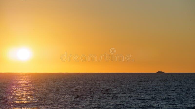 Orange sunset over the sea stock photography