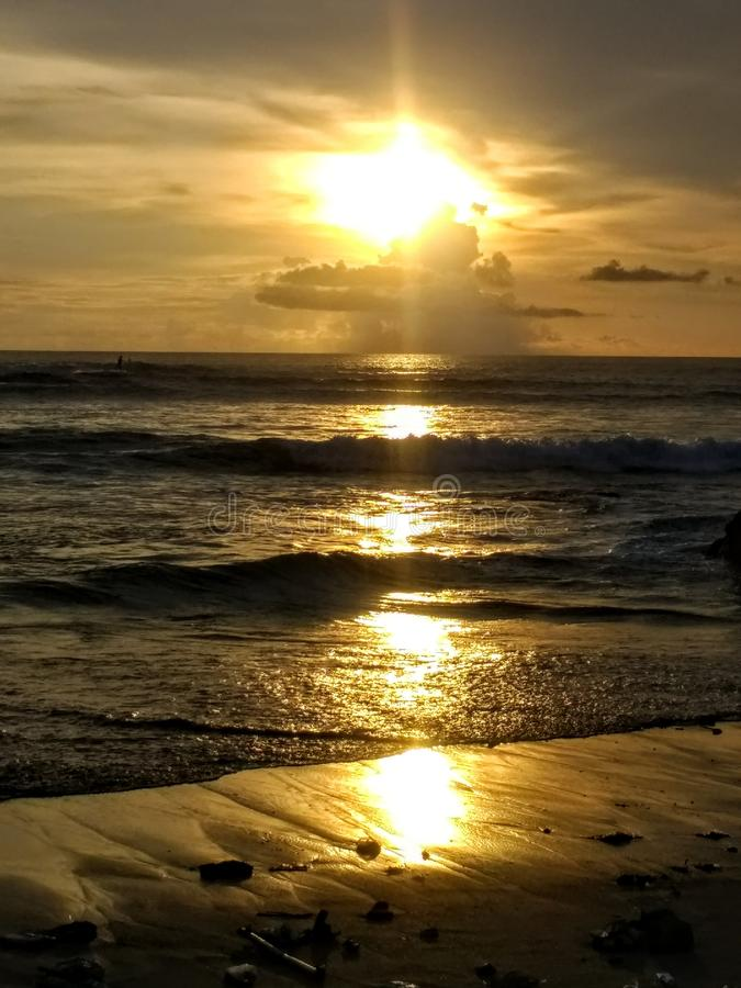 Free Orange Sunset Over The Ocean And Black Sand Beach Royalty Free Stock Image - 145248086