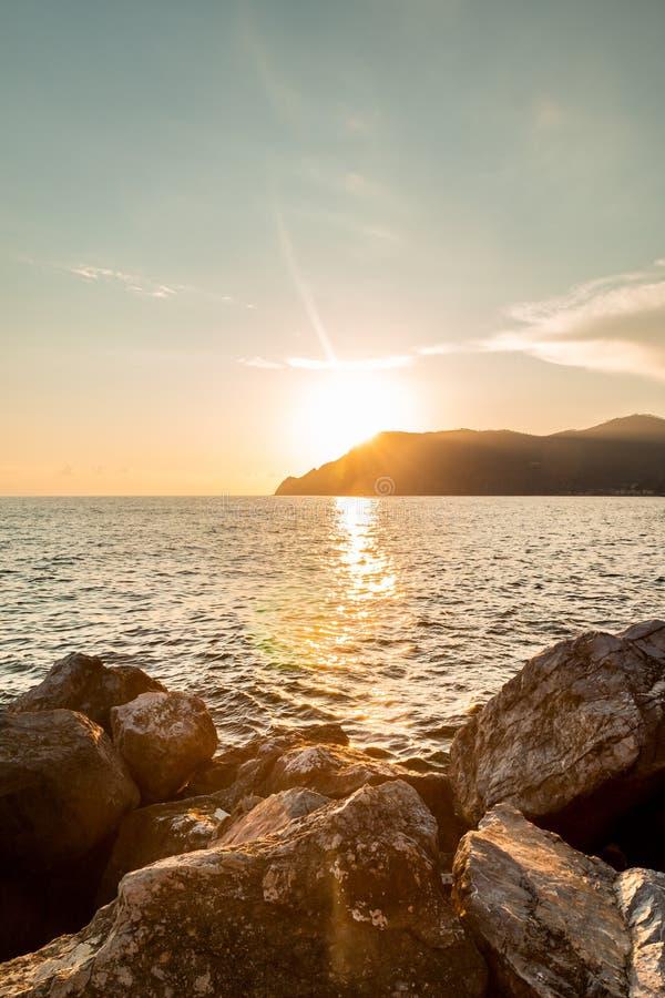 Orange Sunset at sea and rocks. Beautiful Orange Sunset at sea and rocks stock photography