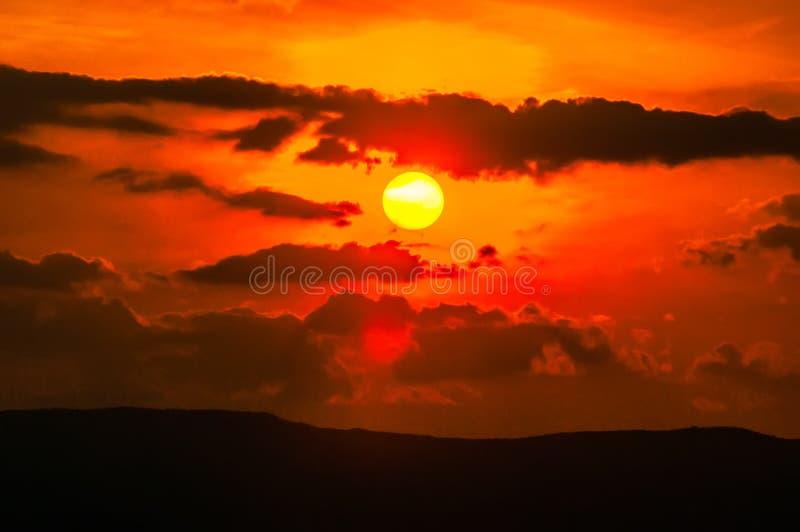 Orange sunset sky and clouds stock photo