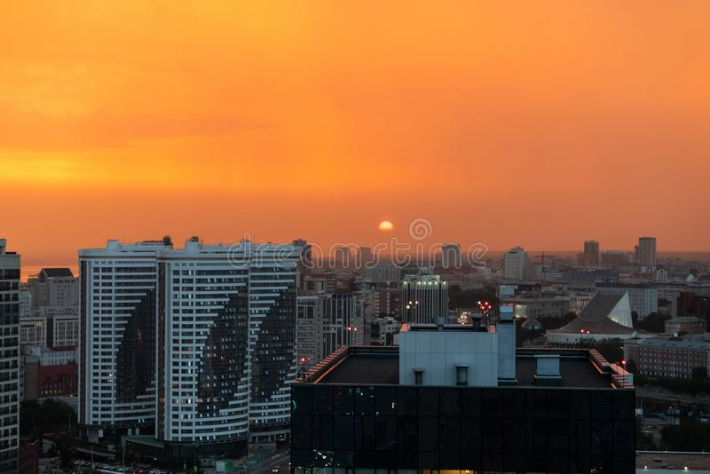 Orange sunset and smog over the city royalty free stock image