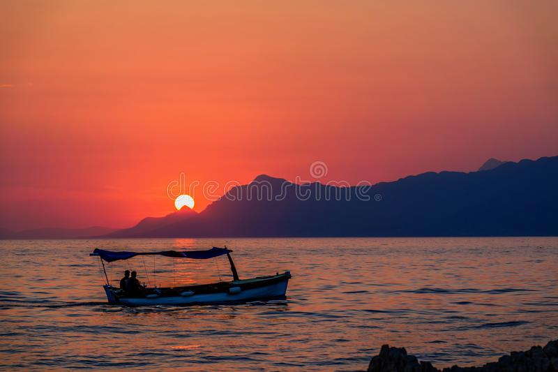 Orange sunset, summer, sea and boat in Croatia. Beautiful orange sunset, summer, sea and boat in Croatia stock image