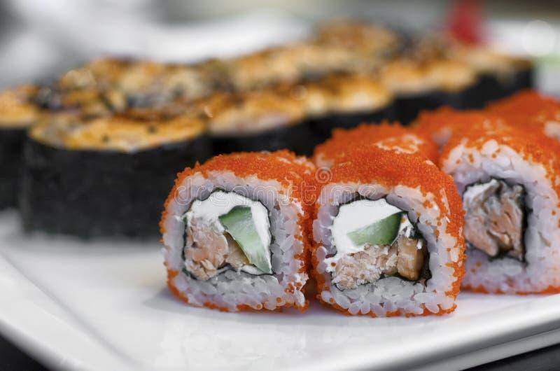 Orange sushi rolls California royalty free stock photos