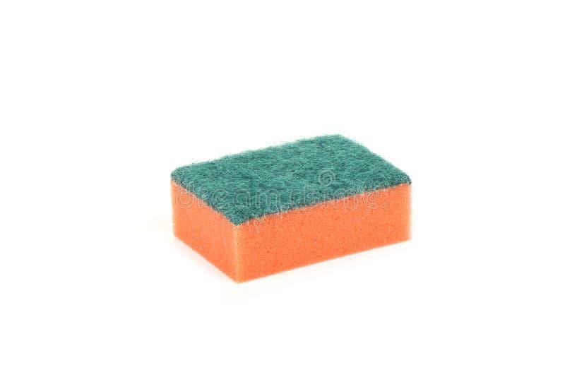 Orange svamp för kök som isoleras på vit bakgrund begreppet av renlighet och hälsa arkivfoton