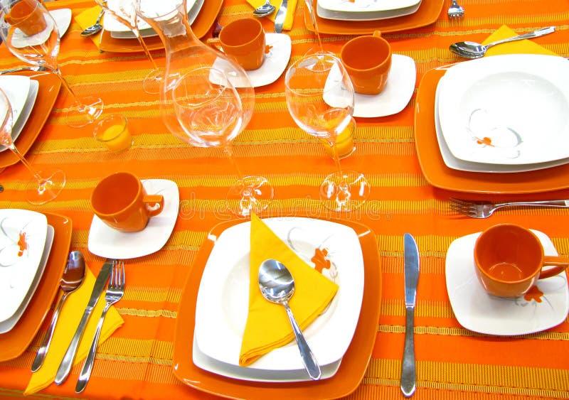 Orange Tabelleneinstellung stockfoto