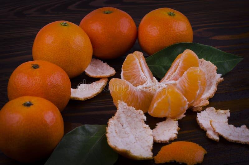 Orange Tangerines with Green Leaves. Tangerine slices stock photography