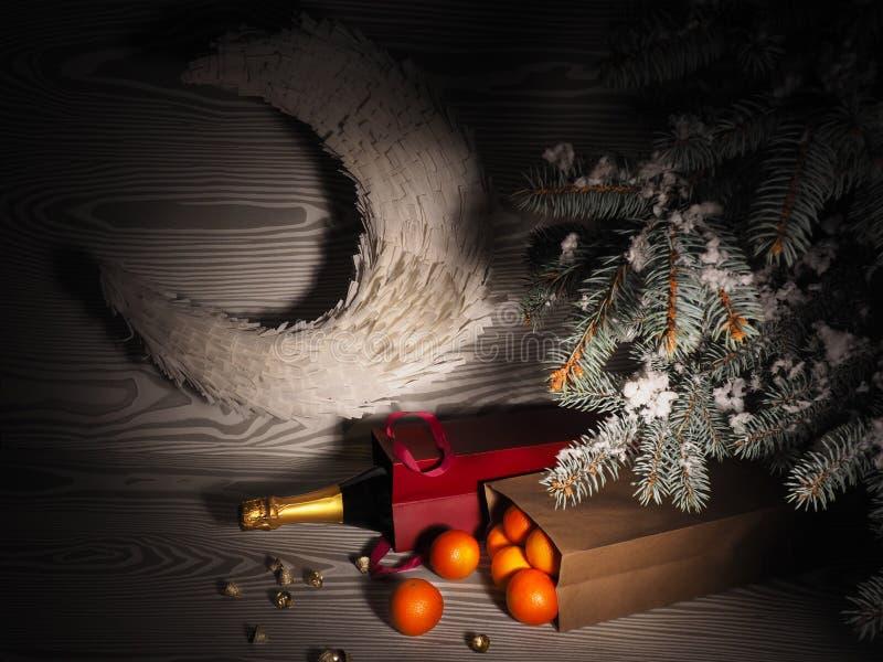 Orange tangerines near winter trees. Christmas mood.  stock photography
