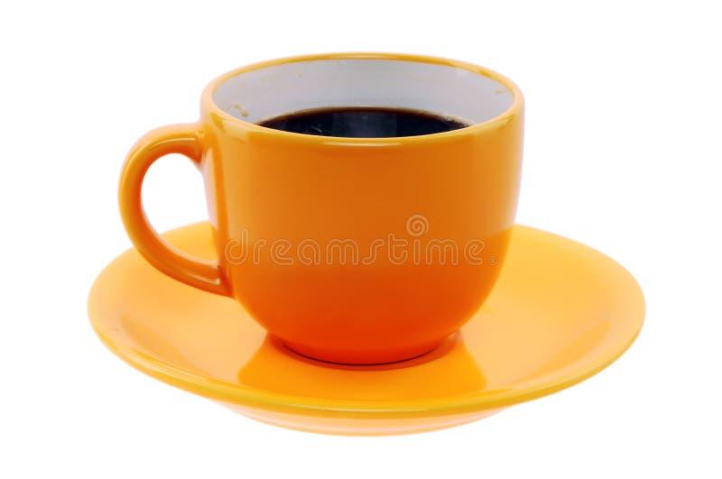 Orange Tasse und Untertasse stockbilder