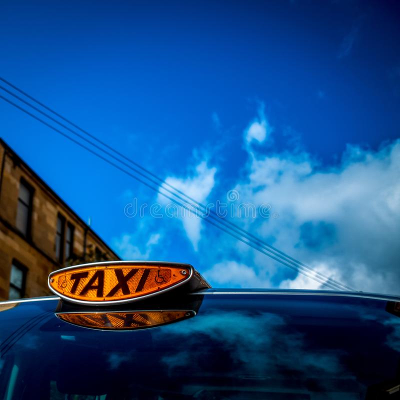 Orange Taxi Light on a Wheelchair Accessible Vehicle With Blue S stock photography