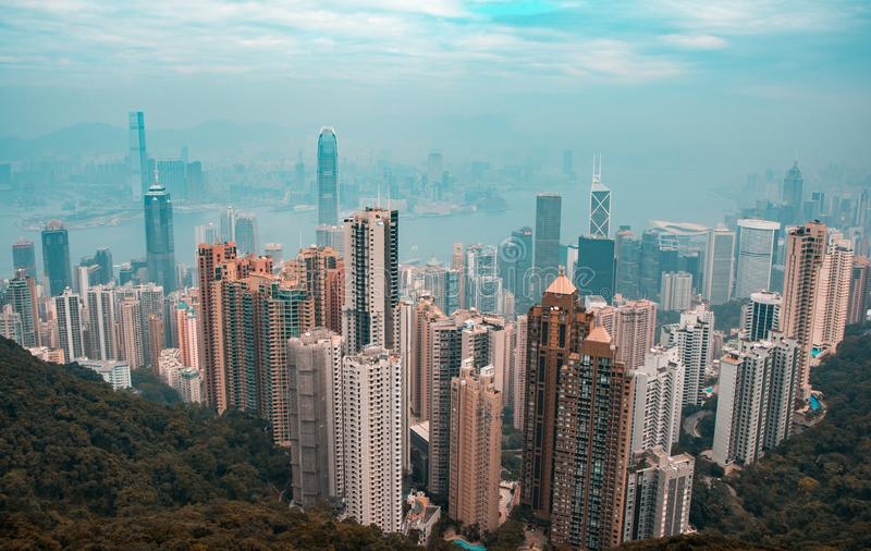 Orange and teal view of Hong Kong skyline from Victoria`s peak stock photo