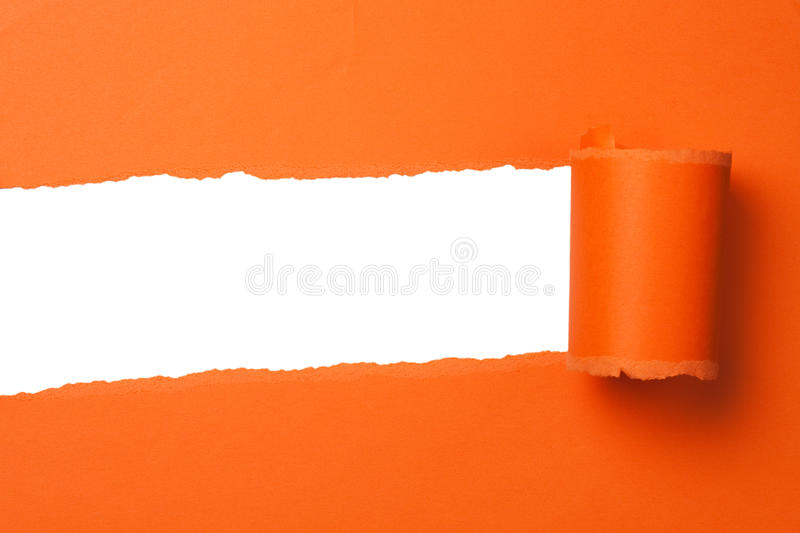 Orange teared paper stock photography