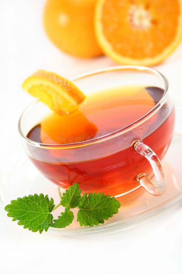 Orange Tee lizenzfreie stockfotos