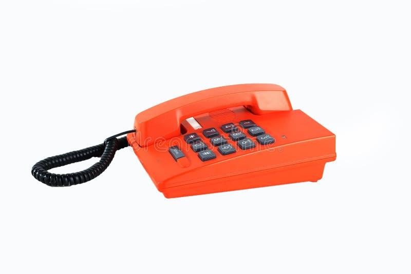 Orange Telefon lokalisiert stockbilder