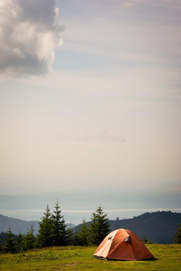 Orange tent in the mountains. In Romania stock photo
