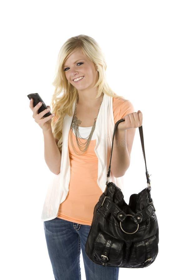 Orange texting Schauen des Hemdes und des Fonds des Mädchens stockbilder