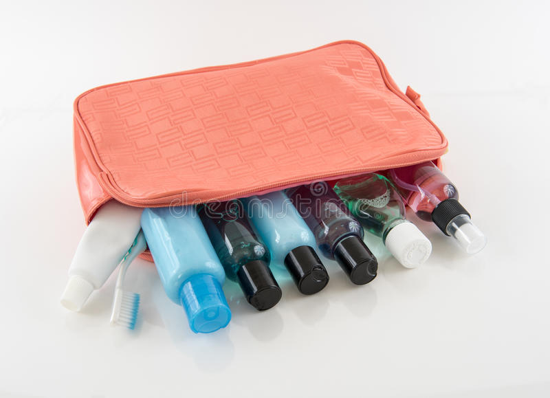 Orange Toiletry Bag with Travel Toiletries. On white background royalty free stock images