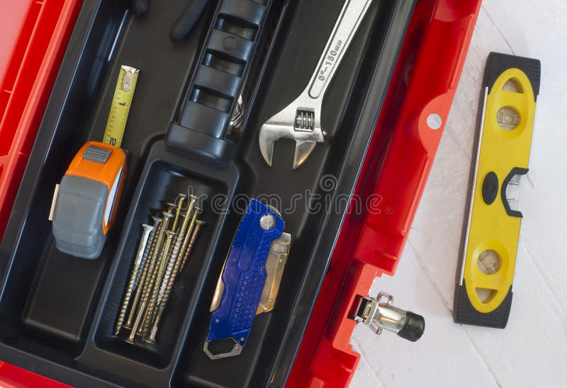 Orange Tool Box Wrench Measuring Tape And Level Stock Photo