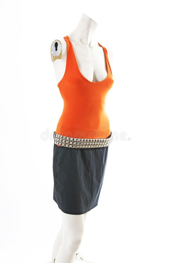 Orange top and black skirt on mannequin full body shop display. Woman fashion styles, clothes on white studio background. Cute royalty free stock photography
