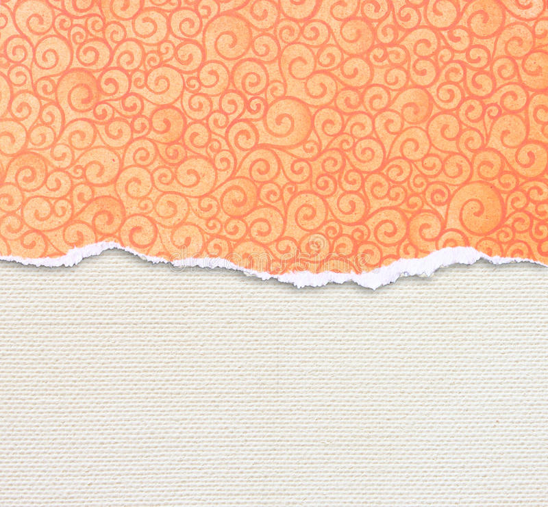 Orange torn paper edge with pattern over canvas background. Orange torn paper edge with pattern over canvas royalty free stock images